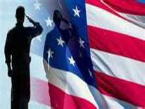 A person saluting in front of an American flag